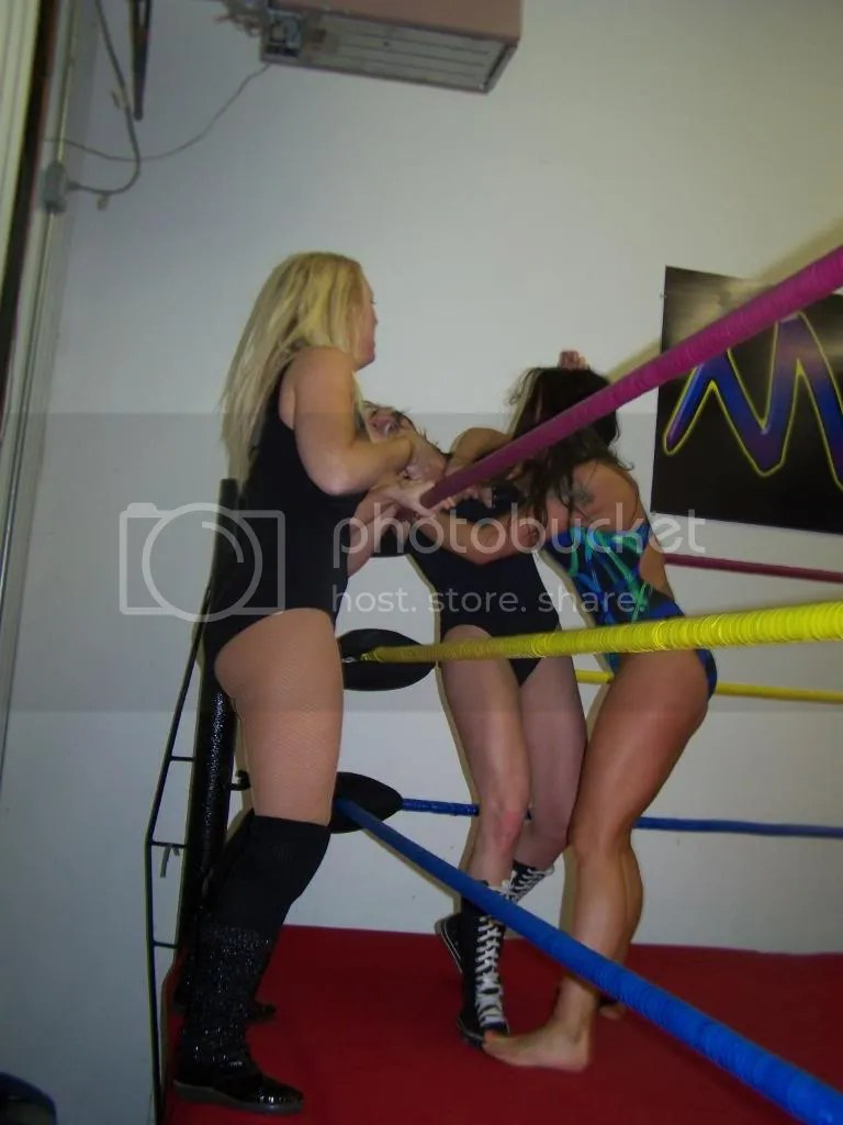 Nikki St. John delivers a hard right forearm smash into the chest of Christie Ricci as Amber O' Neal watches on photo 105_2640.jpg