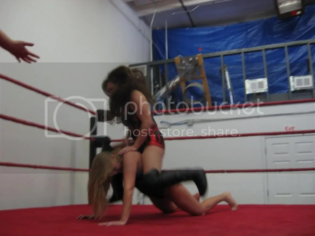 Malia Hosaka drops all of her weight down across the back of Misty James photo IMG_0527.jpg