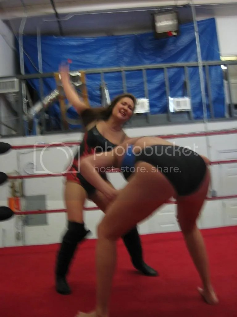 Malia Hosaka isa boutto deliver a hard right forearm smashdown acrioss the back of Misty James photo IMG_0536.jpg