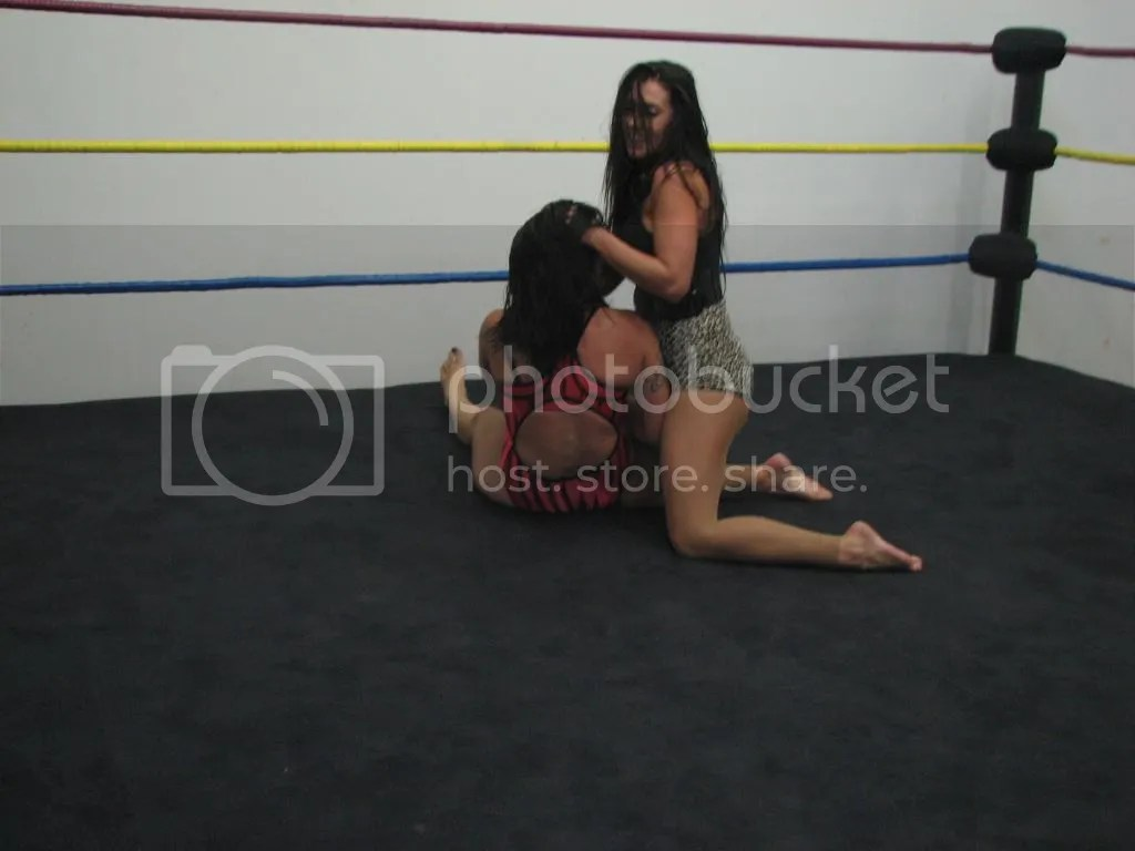 "Santana Garrett picks ""Smokin' HOTT"" Nikki Lane up by her hair..... photo IMG_1855.jpg"