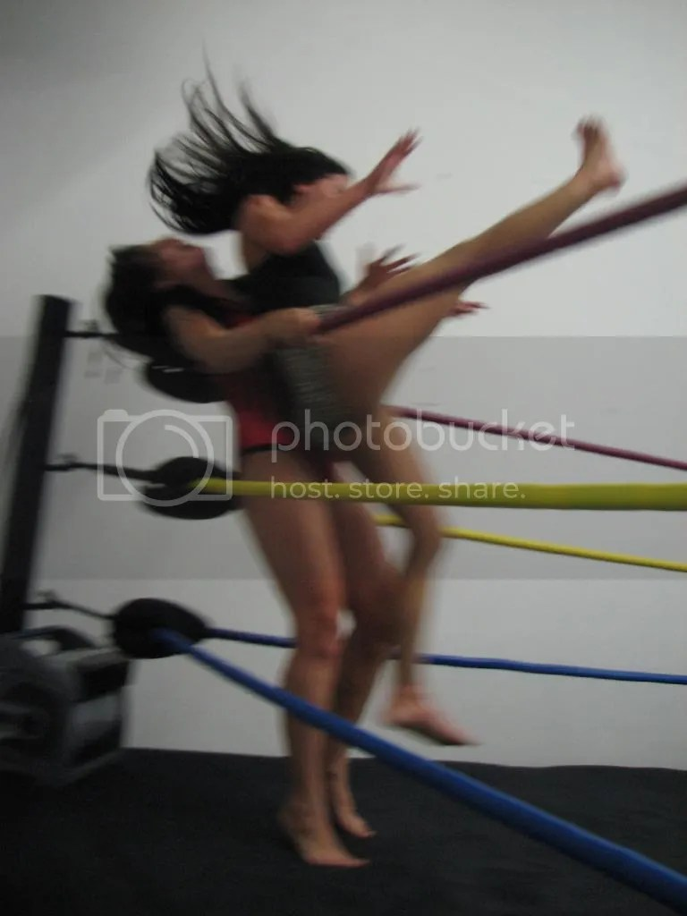 "Santana Garrett does a running handspring back elbow smash into the mid-section of ""Smokin' HOTT"" Nikki Lane in the corner photo IMG_1865.jpg"