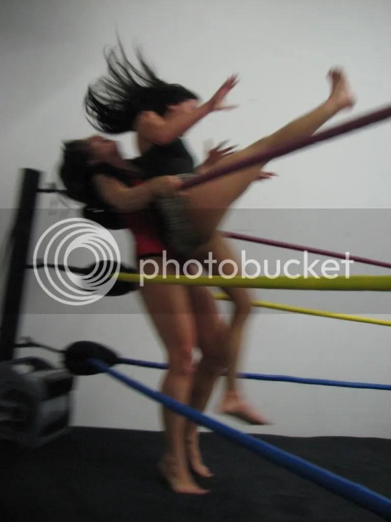"Santana Garrett does a running handspring back elbow smash into the mid-section of ""Smokin' HOTT"" Nikki Lane in the corner photo IMG_1865.jpg"