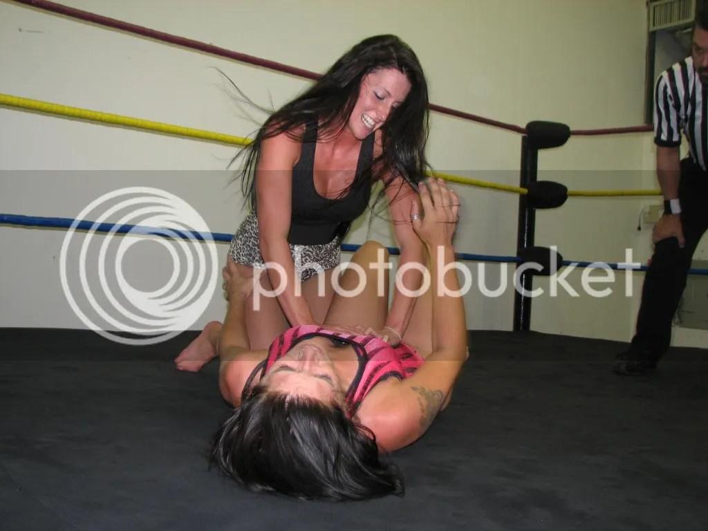 "Santana Garrett relentlessly adds pressure of her double handed abdominal claw onto the abdomen of ""Smokin' HOTT"" Nikki Lane photo IMG_1877.jpg"