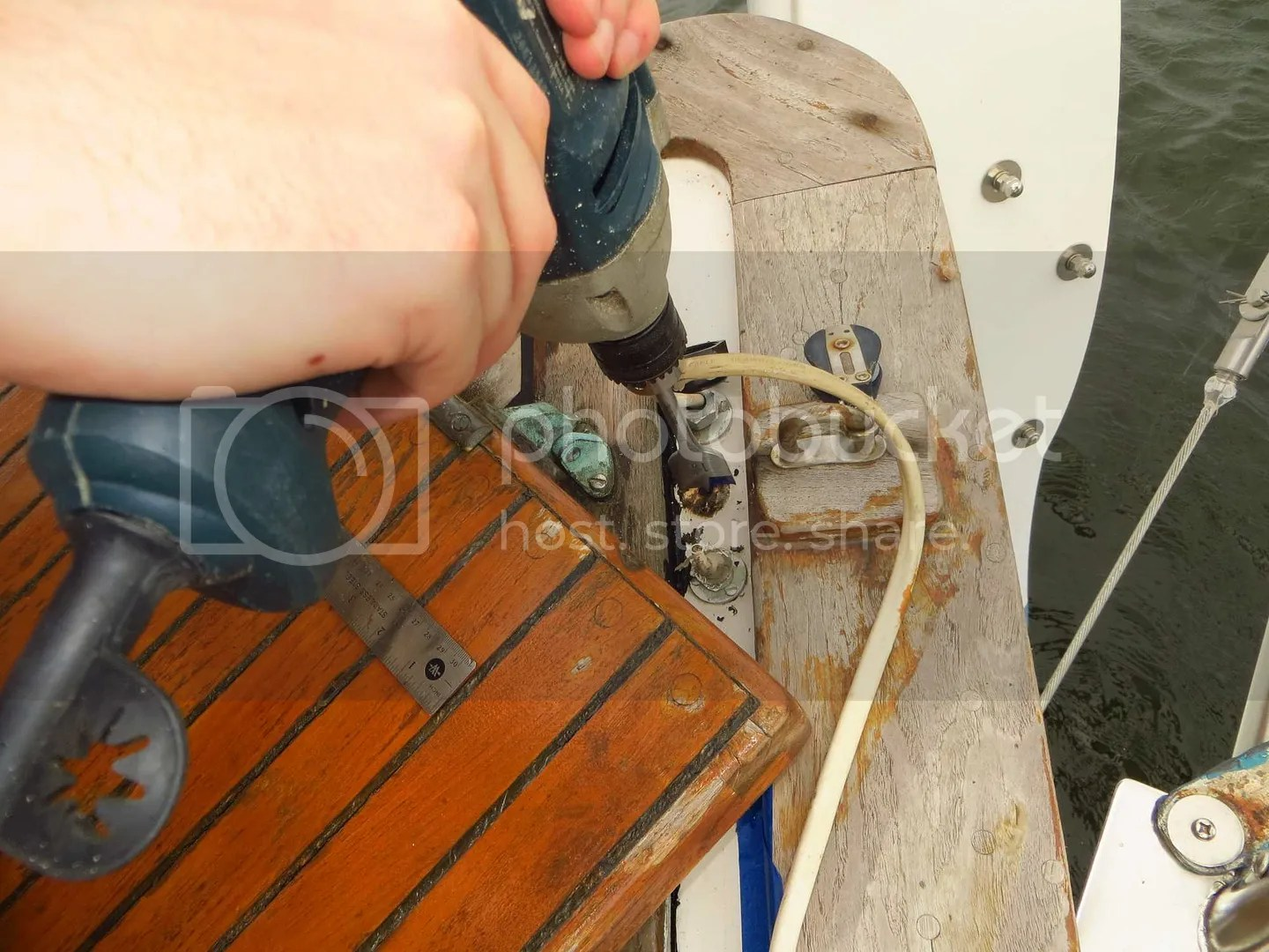 Drilling a hole in the boat for propane hose
