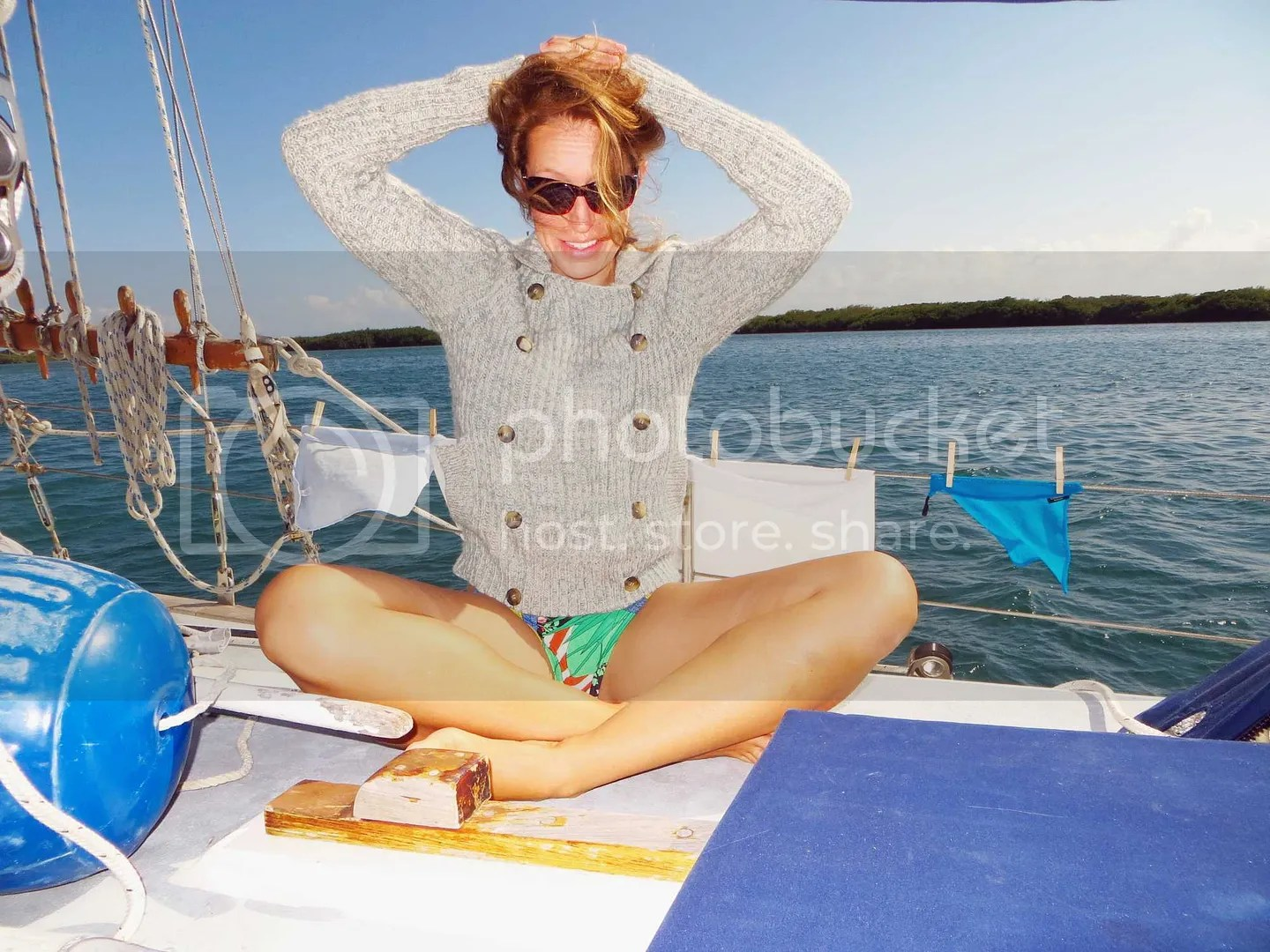 Dani wearing a sweater and bathing suit in Isla Mujeres