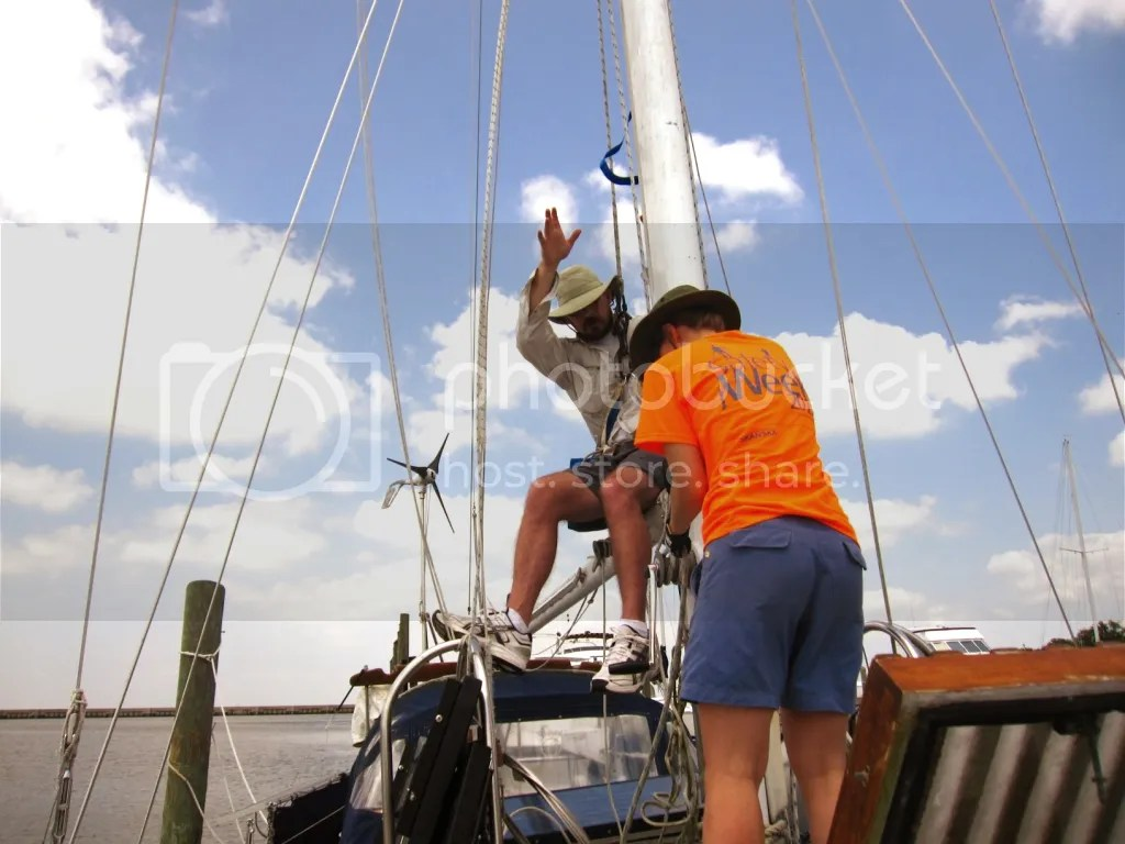 Dani pulling Tate up the mast to change the headstay