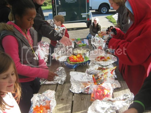 The families preparing their Foil Dinners at the Camptown campout at Fort Harrison State Park in Indianapolis, Indiana