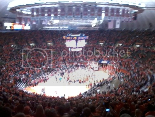 Illinois fans storm the court after the Illini upset number one ranked Indiana