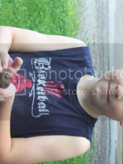 Aiden holding a frog