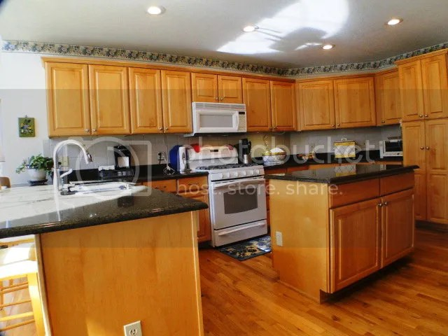 This is a large country kitchen with a family room on one side and formal dining on the other side, Franklin NC Golf Home for Sale, Upscale Properties FranklinNC