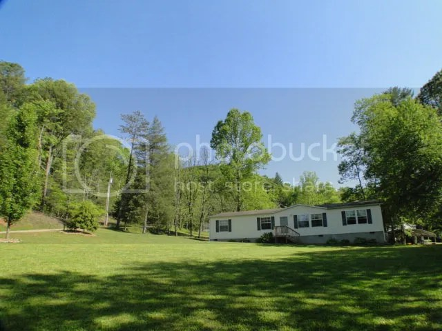 This home has a large one acre flat yard perfect for the kid or grandkids, John Becker Bald Head Franklin NC Real Estate