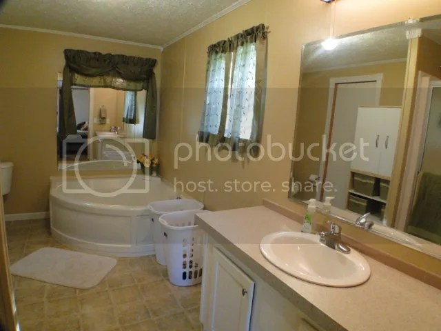The large master suite features a really neat waterfall garden tub in addition to the walk-in shower, Franklin NC Homes for Sale in Cartoogechaye Area