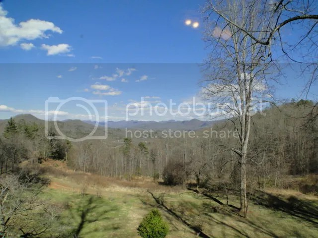 This property has amazing long-range mountain views and is private but not remote, Custom Log Home for Sale with Acreage in NC, Western NC Mountain Homes for Sale