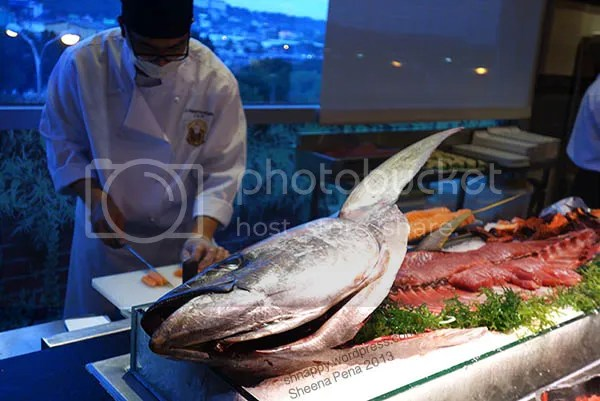 sushi chef making sashimi from a very big tuna at Vikings Marikina