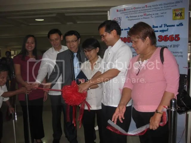 Exhibit ribbon cutting