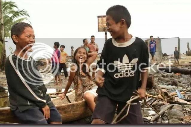 Kids smiling after Typhoon Haiyan