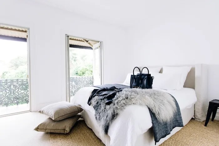 white slipcovered sofa living room chairs ikea le fashion: tour this australian blogger's bright and ...