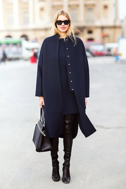 Le Fashion Blog Jessica Hart Model Off Duty Street Style Longline Navy Coat Dress Leather Thigh High Boots Via Carolines Mode