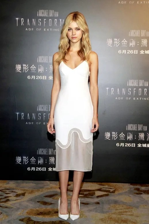 Le Fashion Blog Nicola Peltz White Stella McCartney Sheer Wave Panel Slip Dress Transformers Blonde Wavy Hair Snake Embossed White Pumps photo Le-Fashion-Blog-Nicola-Peltz-White-Stella-McCartney-Sheer-Panel-Wave-Slip-Dress-Transformers.jpg