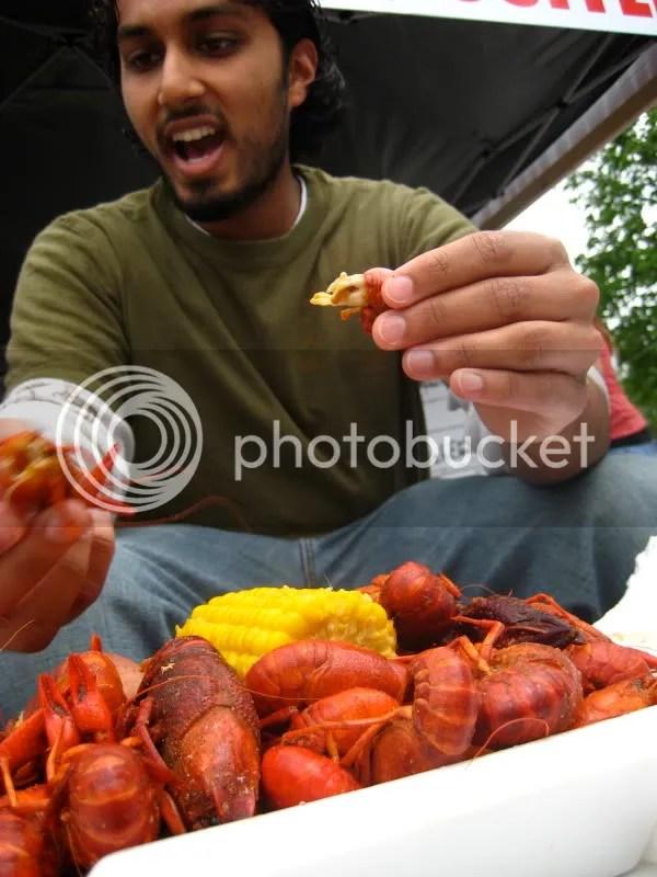 Sajan eats crawfish