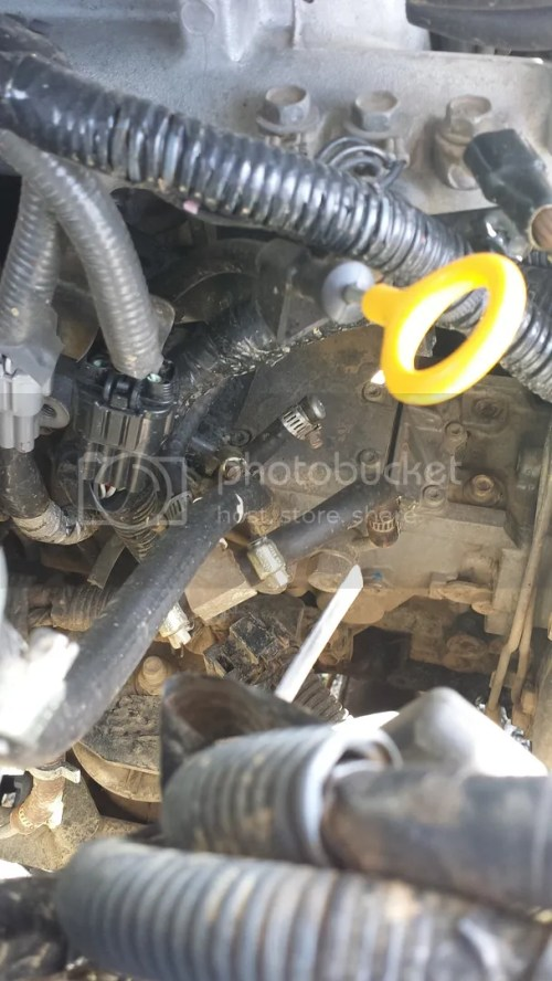 small resolution of as you can see in this photo there is a little fuel hose coming out under the intake manifold and joins into the large fuel line from the fuel filter at the