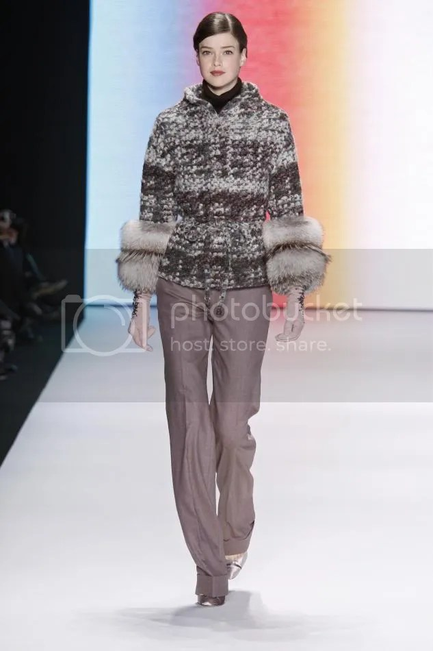 8.Julia: Bone, mauve, and cocoa mohair boucle jacket with fox sleeves, light amethyst wool trouser, gunmetal and primrose suede gloves