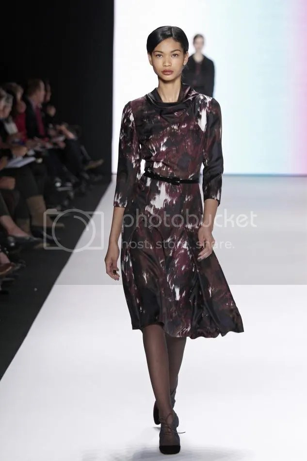 14. Chanel: Amethyst, cocoa, and bone abstract waterfall print silk crêpe cowl neck dress and cocoa velvet belt