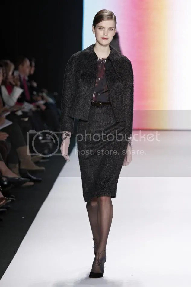 15. Mirte: Amethyst, cocoa, and bone abstract waterfall print and mélange wool dress, black and cocoa mélange wool cropped jacket, amethyst velvet belt, gunmetal and primrose embroidered suede gloves