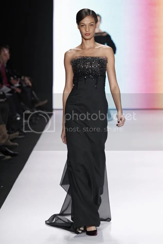 32. Joan:Black embroidered silk and wool organdy handkerchief strapless gown.