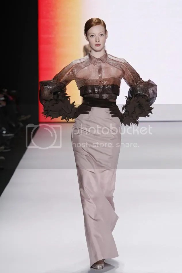 38. Rust abstract print organza blouse, primrose silk faille skirt, cocoa grosgrain embroidered gloves.