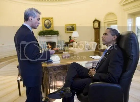 President Obama talks with his Chief of Staff in the Oval Office on day one...