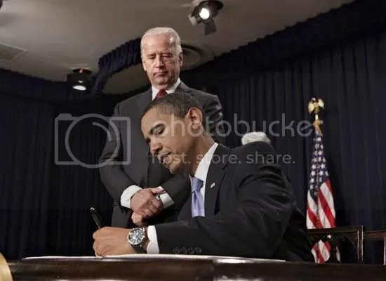 Obama signs executive orders during a meeting at the Eisenhower Executive Office Building...