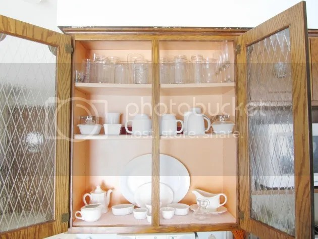 white dishes apricot cabinets