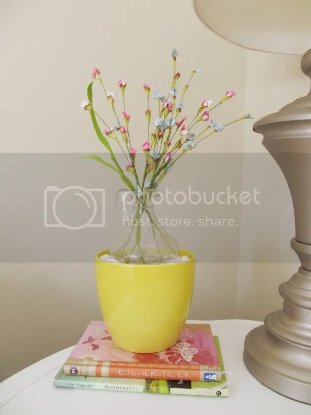 yellow pot with faux spring flowers