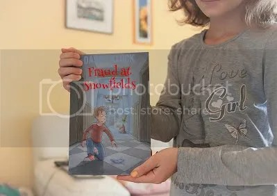 photo Fraud at Snowfields girl holding print copy_zps5a7bsr4r.jpg
