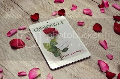 photo Crimson Roses on tablet with rose petals_zpssn9nottd.jpg