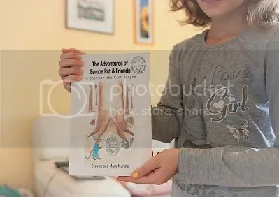 photo The Adventures of Samba.. girl holding print_zps3mj6a7wu.jpg