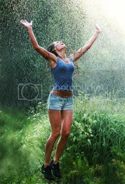 woman rejoicing in rain