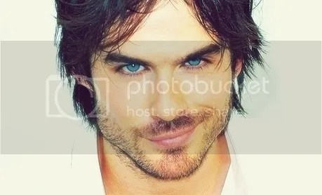 Ian Somerhalder with one side of his lips curled up in a seductive smile- image