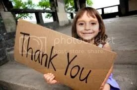 Girl holding thank you sign