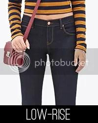 Model wearing low-rise jeans.