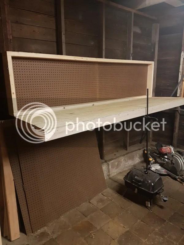 Wall mounted folding workbench