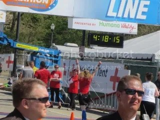Me crossing the finish line of the Kentucky Derby Festival Marathon - Louisville, Kentucky