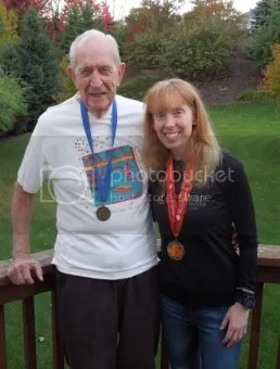 My grandpa, Howard A. Brady, in his 1993 Twin Cities Marathon Finisher's shirt and medal and me in my 2014 gear! Running...it's a generational thing!