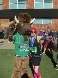 Me with Marco, the mascot of the Marshall University Thundering Herd, after I finished.  I was still smiling!