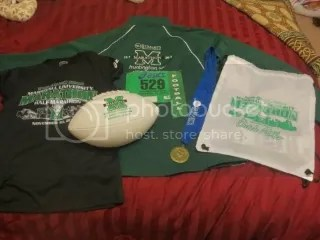 The swag from the  Marshall University Marathon - Huntington, WV.  Not pictured is the 26.2 magnet you get after you finish as well. I forgot I stuck it on my fridge.  It's in the green and white Marshall University colors.