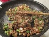 Neat - A Healthy Replacement For Meat Mexican Mix (in a skillet with chopped onion and chopped green pepper)