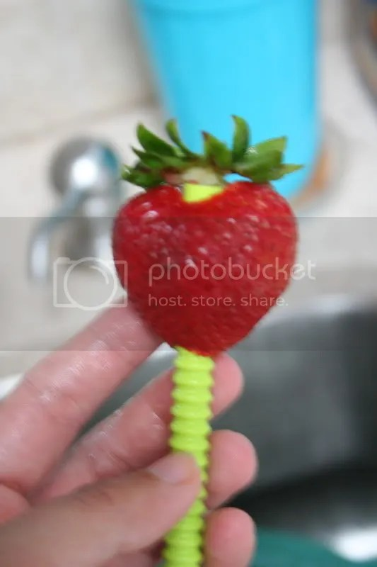 Core the strawberries with a straw.
