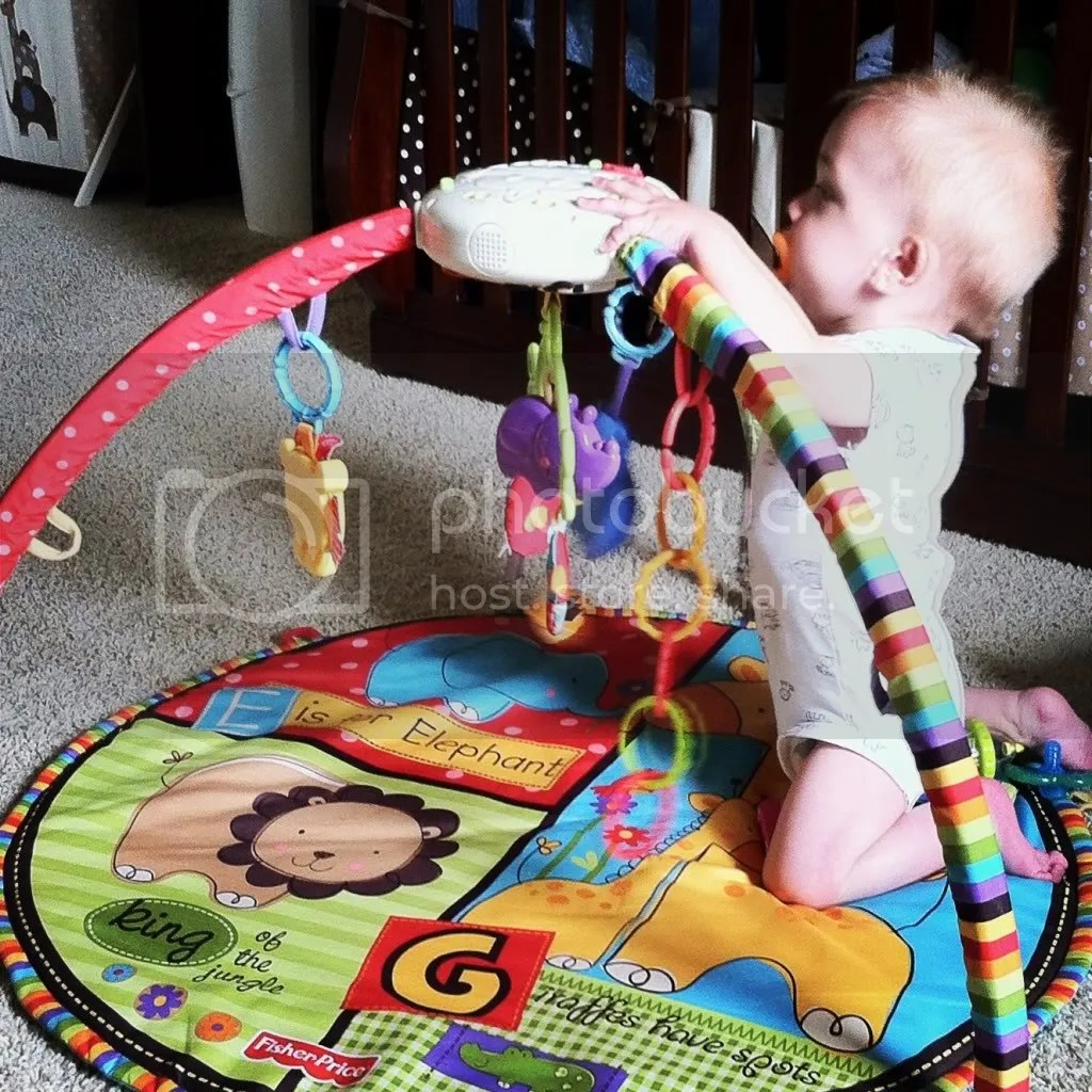 Playing with his Playmat