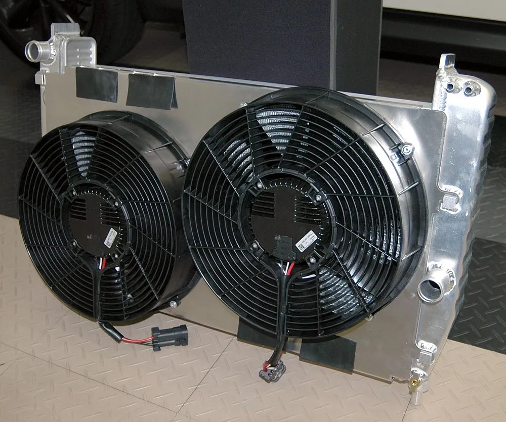 hight resolution of the entire assembly measures 6 3 8 if you inclde the condenser mounting tabs or 6 without them